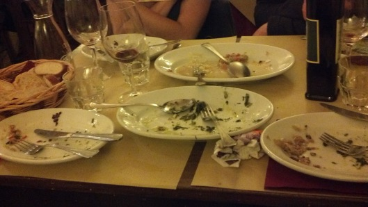 Empty plates after a delicious meal in Orvieto.