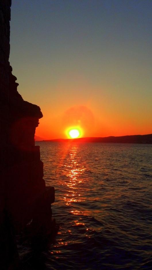 Sunset on the water in Ayvalik, Turkey.